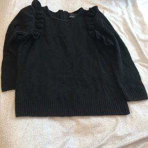 A used sweater top.